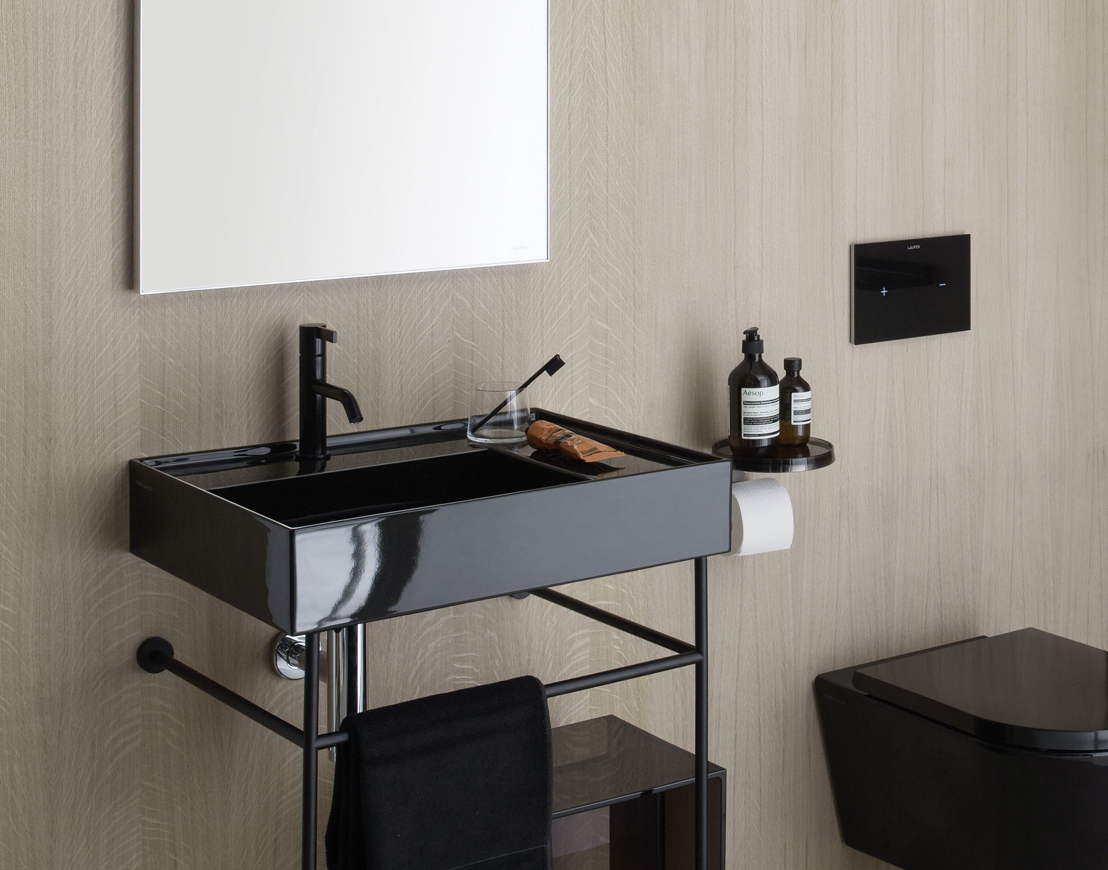 Black in the bathroom? The new Kartell by Laufen washbasin with towel rail (also available in chrome) Read more: http://www.ish.laufen.com/LAUFEN_ISH_EN/en_eng/sa_ish/sa_products/
