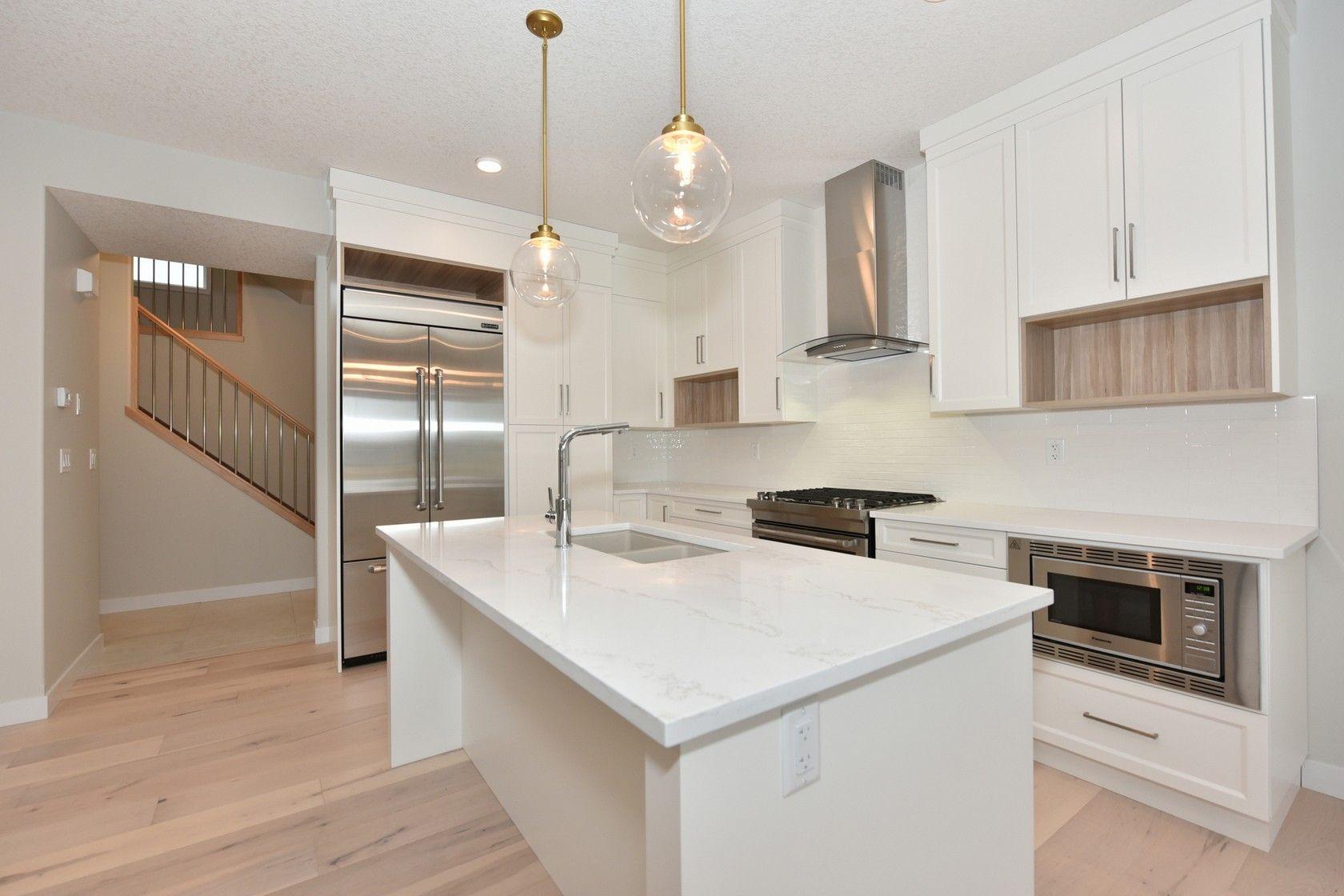 a goegeous strato quartz island home additions quartz kitchen kitchen remodel on kitchen island ideas white quartz id=70972