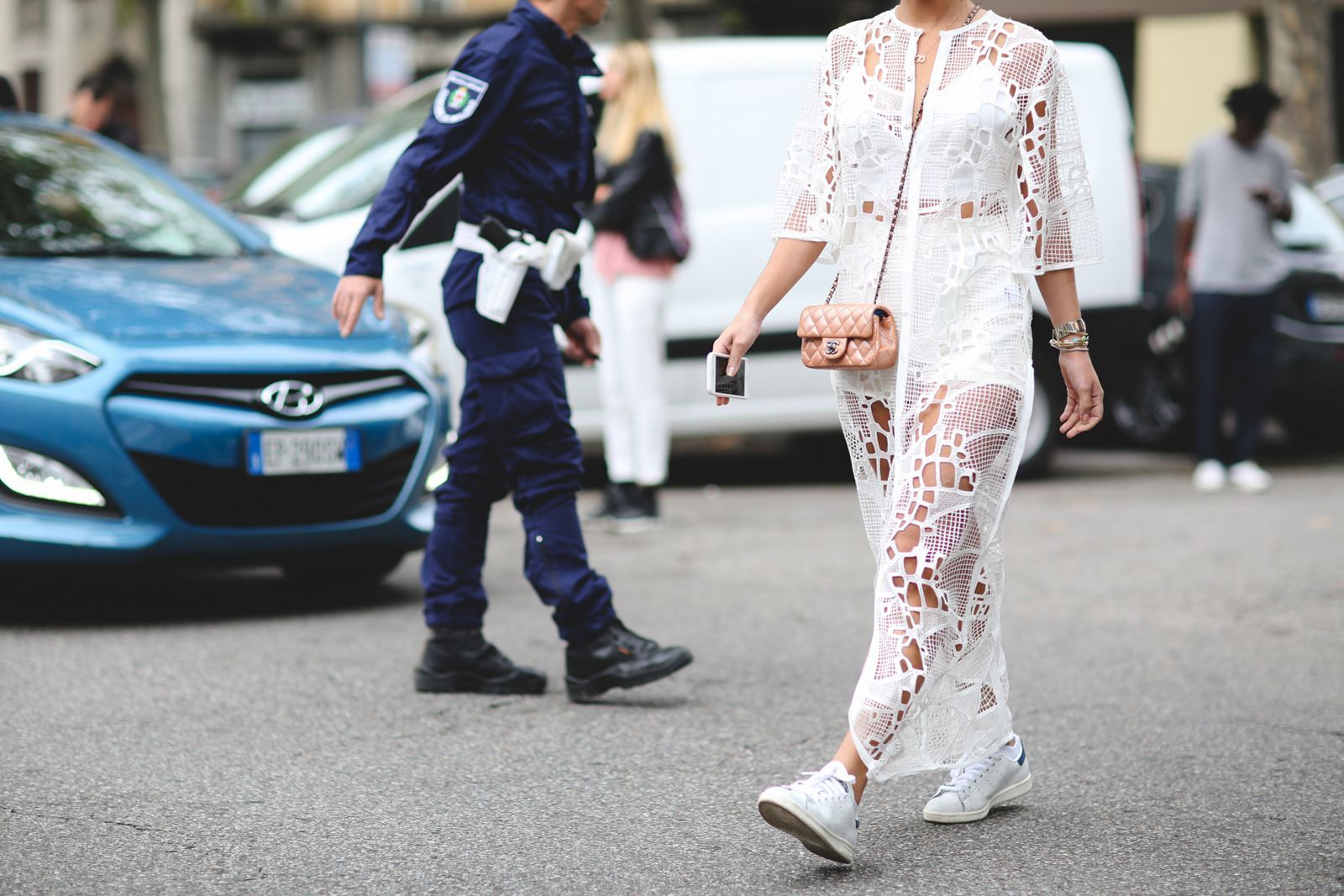 A sheer, lacy number that legitimately stops traffic. #refinery29 http://www.refinery29.com/2015/09/94857/milan-fashion-week-spring-2016-street-style-pictures#slide-41