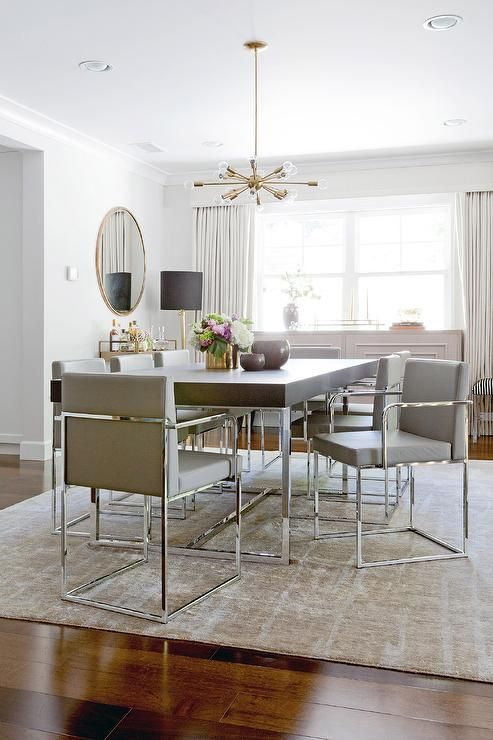 Contemporary Dining Room Features A Brass And Glass Sputnik Chandelier  Illuminating A Wood And Chrome Dining Table Lined With Gray Leather Dining  Chairs ...