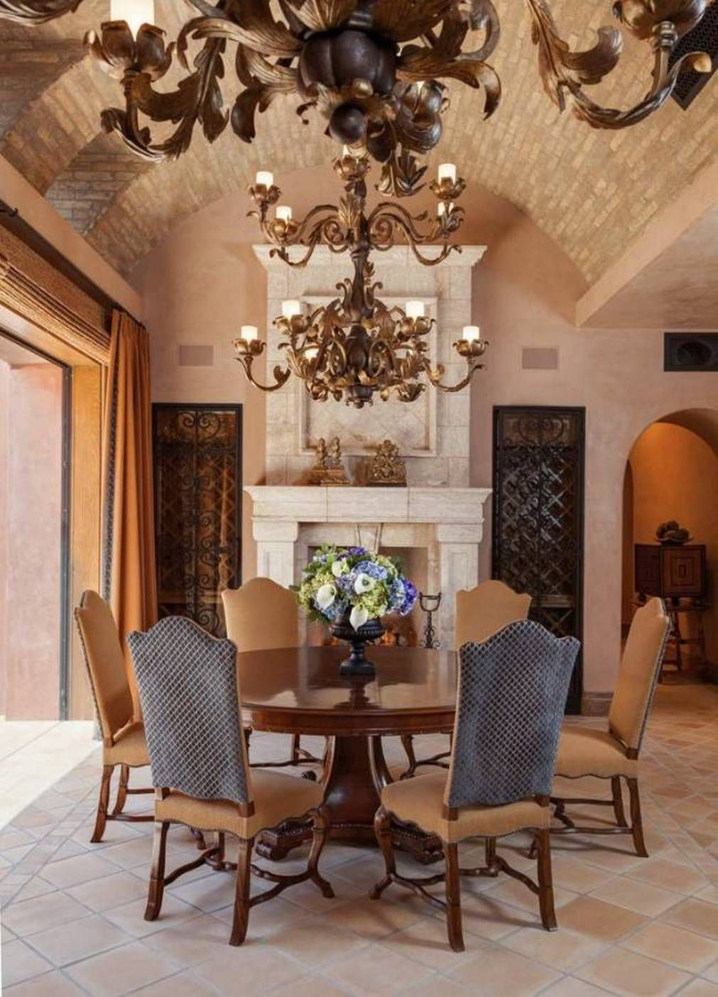 Dining Room , Inviting Tuscan Style Dining Room : Tuscan Style Dining Room  With Double Chandeliers And Curved Brick Ceilind And Fireplace And Round  Dining ...