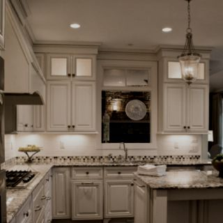 Love the small lit cabinets on the top.. would add some height to reg. ceiling. add crown molding