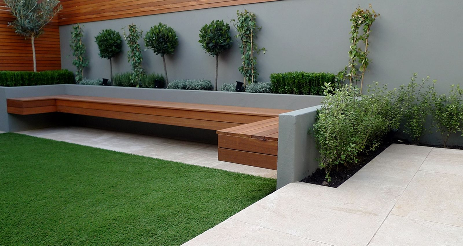 small garden design and landscaping seating raised bed paving fake grass screen hardwood