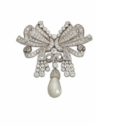A natural pearl and diamond brooch, circa 1950 -  The highly stylised ribbon bow set throughout with old brilliant, single and baguette-cut diamonds, suspending a large natural pearl drop, diamonds approximately 9.50 carats total, length 8.2cm