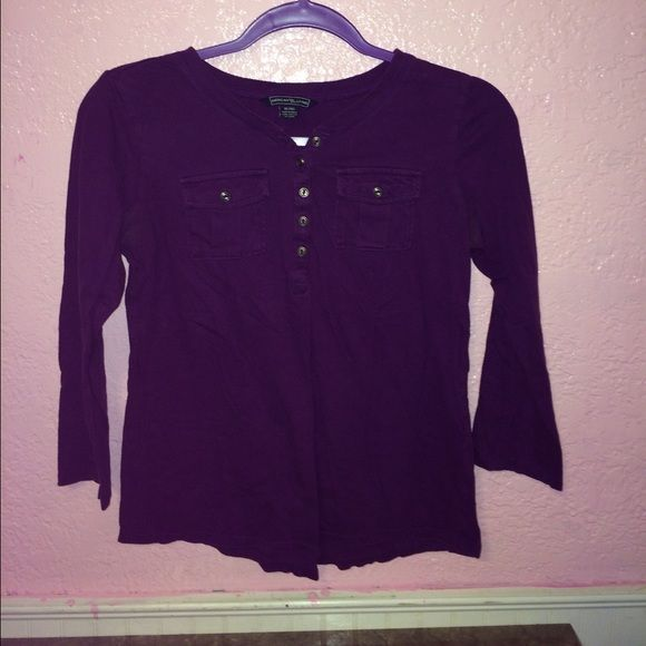 Purple half bottom up shirt Purple shirt. Has been worn but still in good condition. American living Tops Blouses