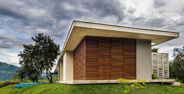 ebenerdiges haus h gel beton holz fassade bungalow pinterest haus flachdachhaus und bau. Black Bedroom Furniture Sets. Home Design Ideas