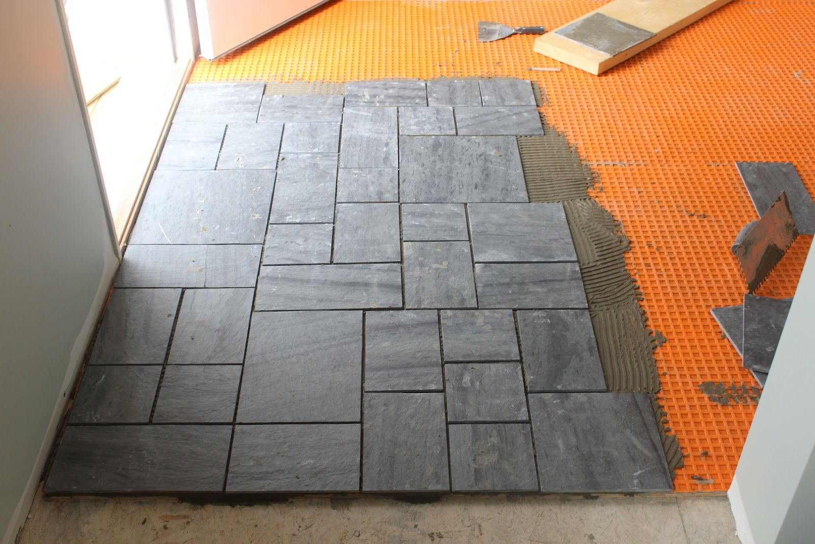 tile flooring near setting floor house slate floors door pool progress