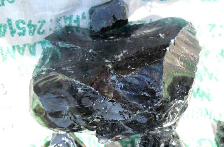 Volcanic glass, also known as Obsidian. When this glass is flaked it has the sharpest edge that is naturally made.