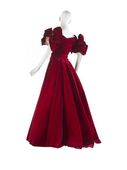 "Evening Dress, House of Worth: 1900, French, velvet, ribbed silk. ""The richness of the jewel-toned velvets produced at the end of the 19th century in France, obviated any need for embellishment. Here Worth has showcased the powerful ruby red of this evening dress with a simple, sleek skirt and stylized, wired bow sleeves...comparable austere, simple dresses were favored attire for formal portraiture and appear on many of the sitters portrayed by John Singer Sargent."""