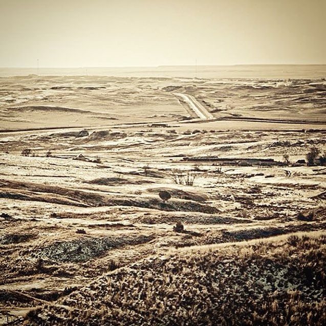 Montana goes on and on and on #forever #montana #sepia #landscape #endlesshills #ranch #cattle #cowboy #grasslands #badlands #puremidwest #travel #countryfeatures #photo #photooftheday #beautifulbakken #mykuhlsphotography