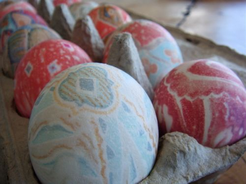 """Silk Dyed Easter Eggs- Wrap raw eggs in 7"""" square from 100% silk tie, print side against egg & tie well. Then wrap with white cotton square & tie well. Cover eggs completely with water in glass, enamel, or stainless pot. Add 3 Tbsp white vinegar, bring to a boil, lower to med high to boil for 15 mins. Remove eggs, cool, & unwrap. To make shiny, rub with vegetable oil."""