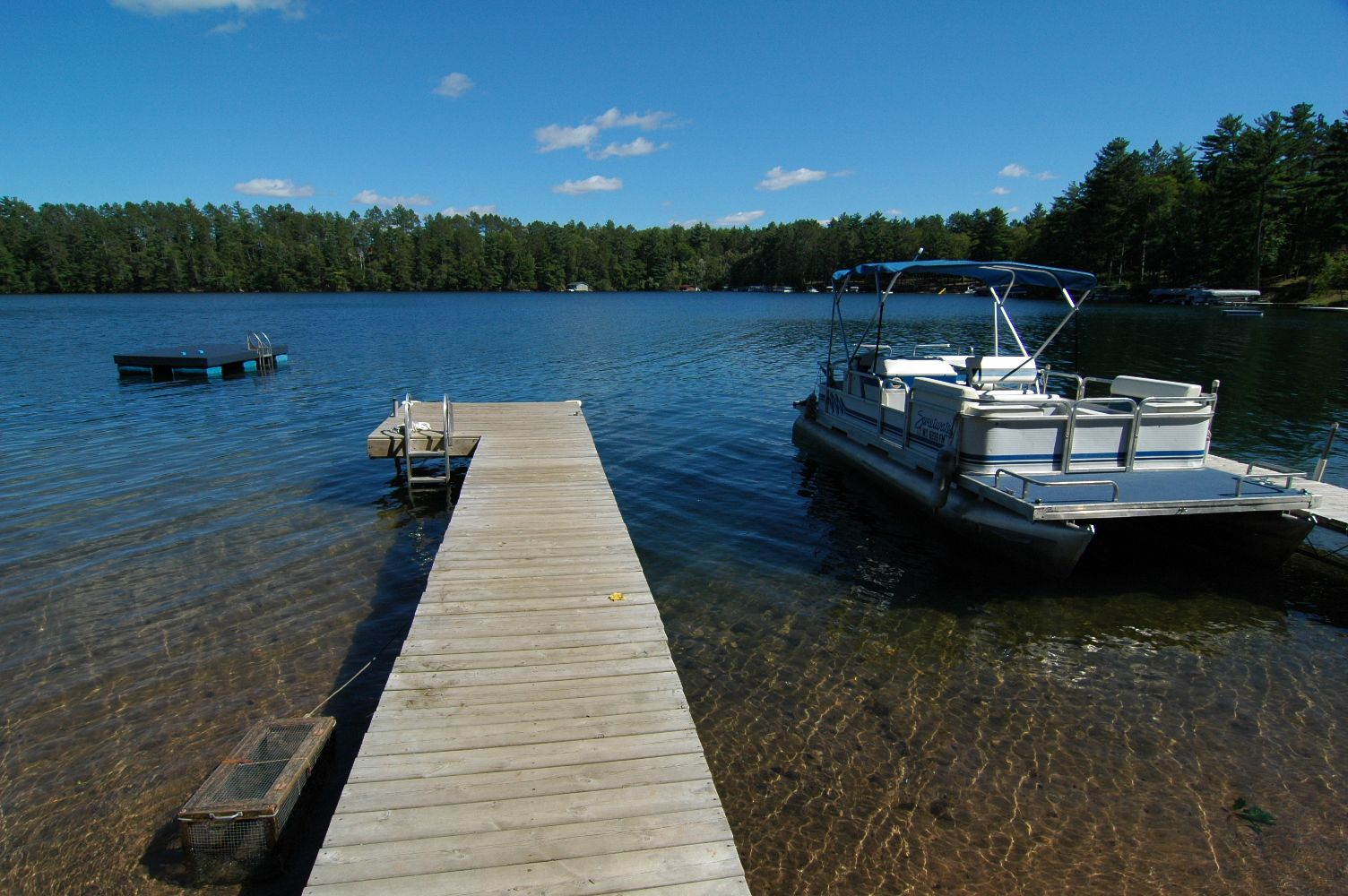Sandy beach, crystal clear water at Lake Owen Resort, Cable, Wisconsin