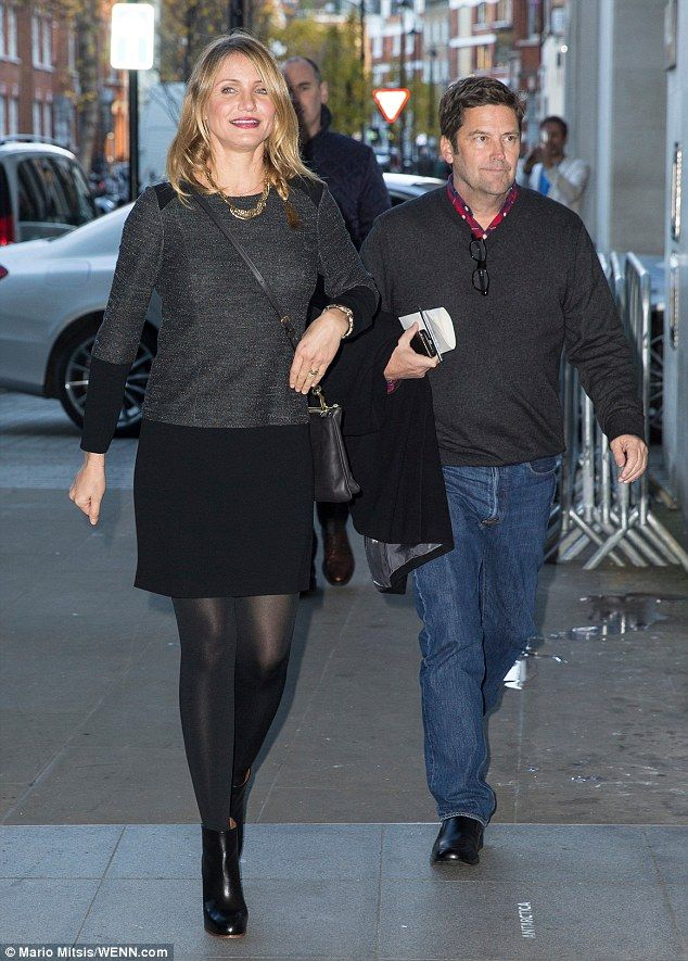 3bd768f4a4ec4 Looking good: Cameron sported a grey and black minidress with black tights  and matching le.