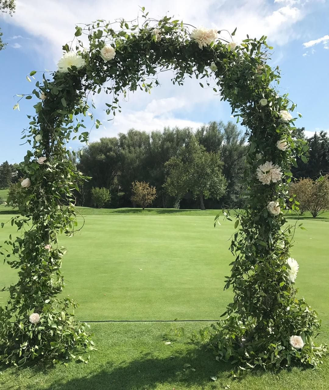 Greenery And White Flower Arch By Plum Sage Flowers Featuring Smilax