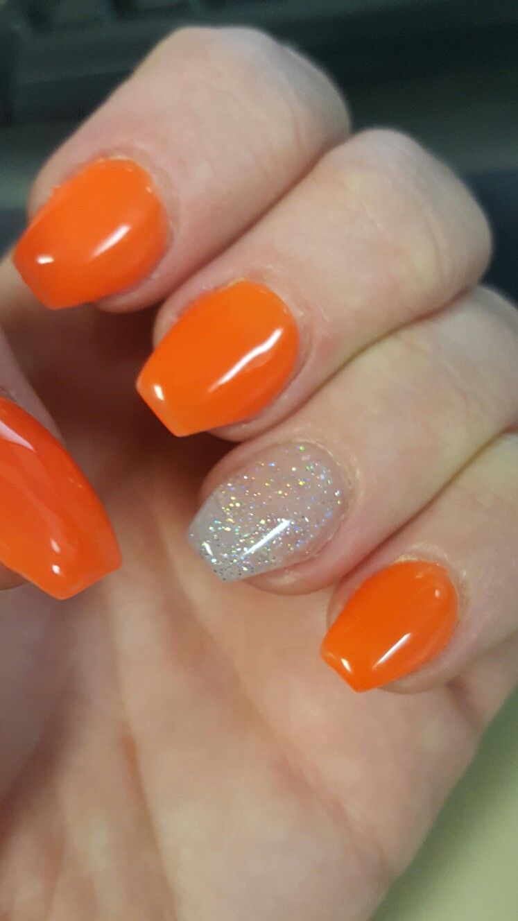 Short coffin nails  Highlighter orange with a glitter accent