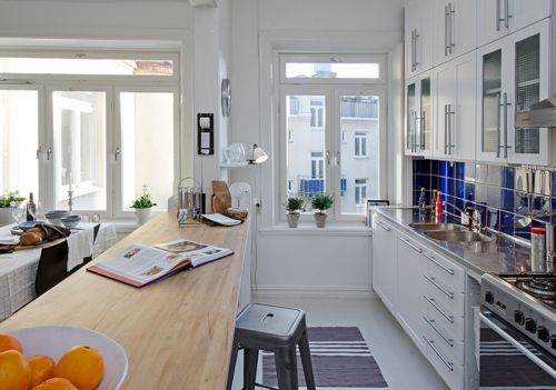 love this long kitchen counter for a workspace and/or bar for