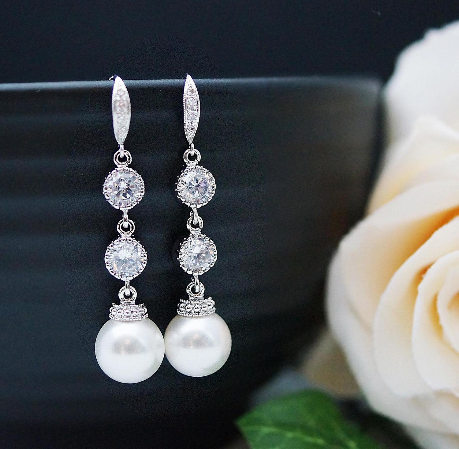 Wedding Bridal Jewelry Bridal Earrings Bridesmaid Dangle Earrings Gifts Crystal White Swarovski Pearls and Cubic Zirconia Connectors. $36.80, via Etsy.