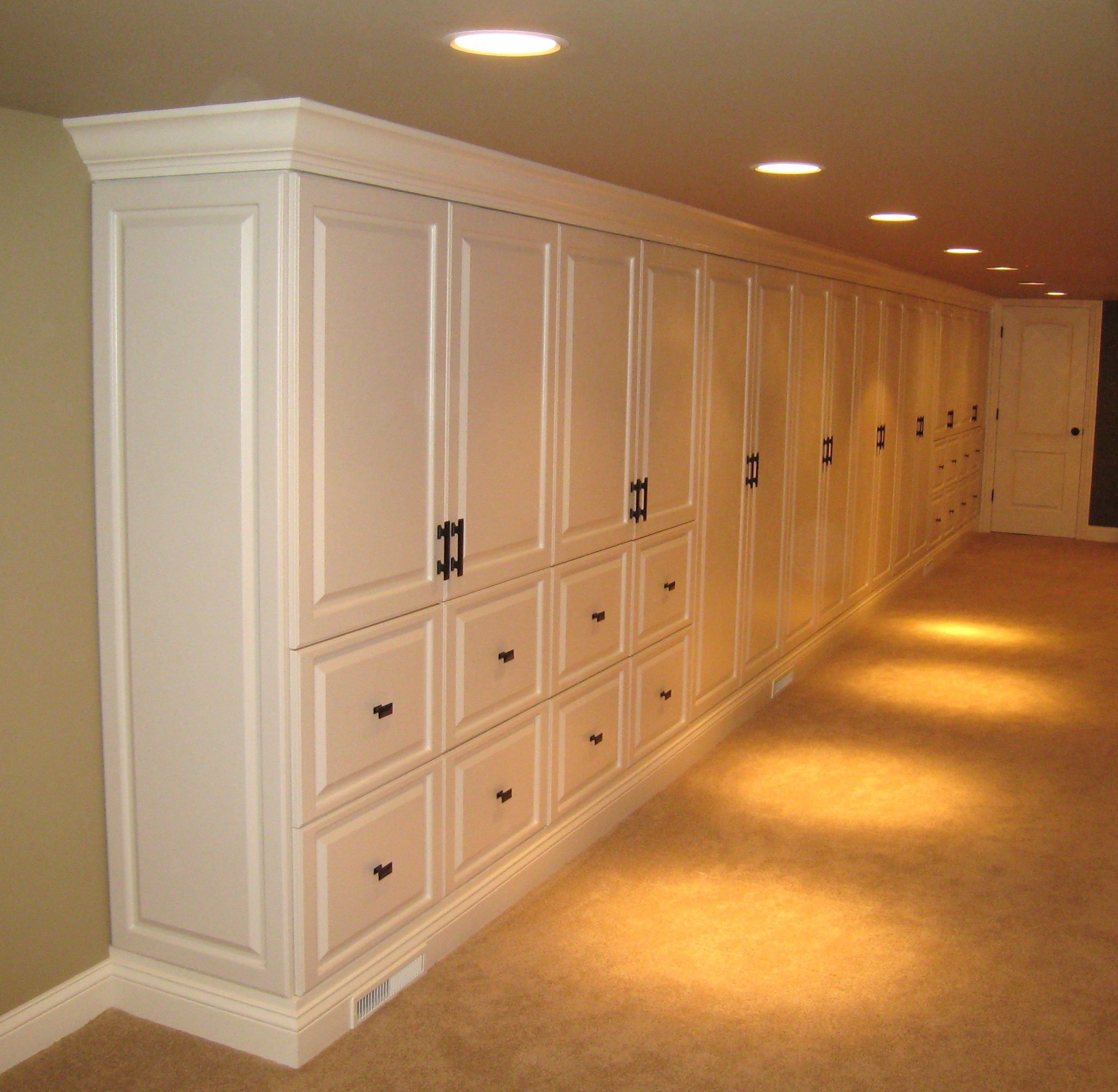 Formal storage cabinets in basement family room  Builtin Cabinets in 2019  Basement storage