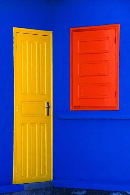 Bright Yellow Door   & Red Wibdow