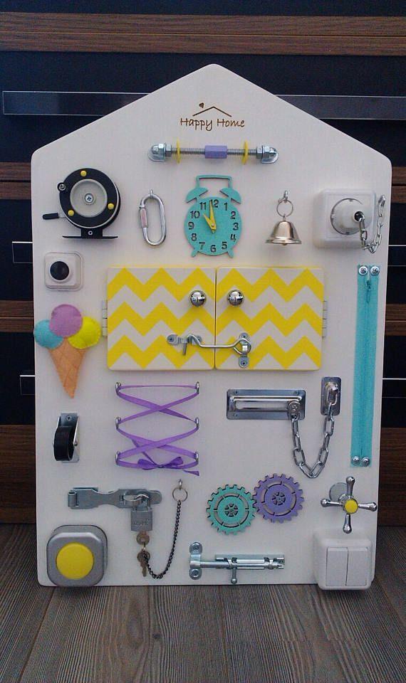 Busy board Toddler sensory Activity board | Panneaux ...