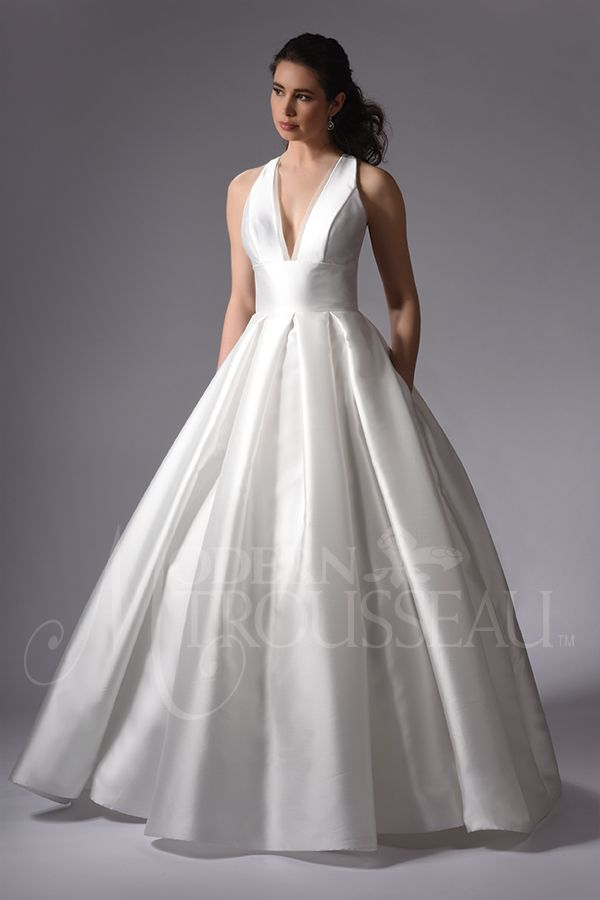 0c4b94507 Stunning silk gown with an inverted box pleat skirt, pockets and chapel  train. The bodice has a dramatic V – neckline and lace detail in back.