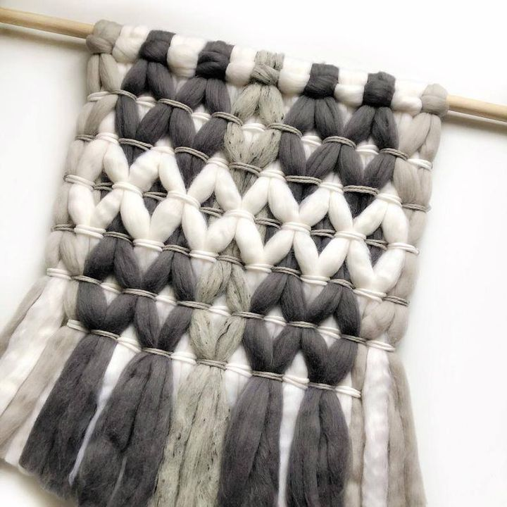 If you love cozy knits, you'll love this woven wall tapestry made with wool roving.
