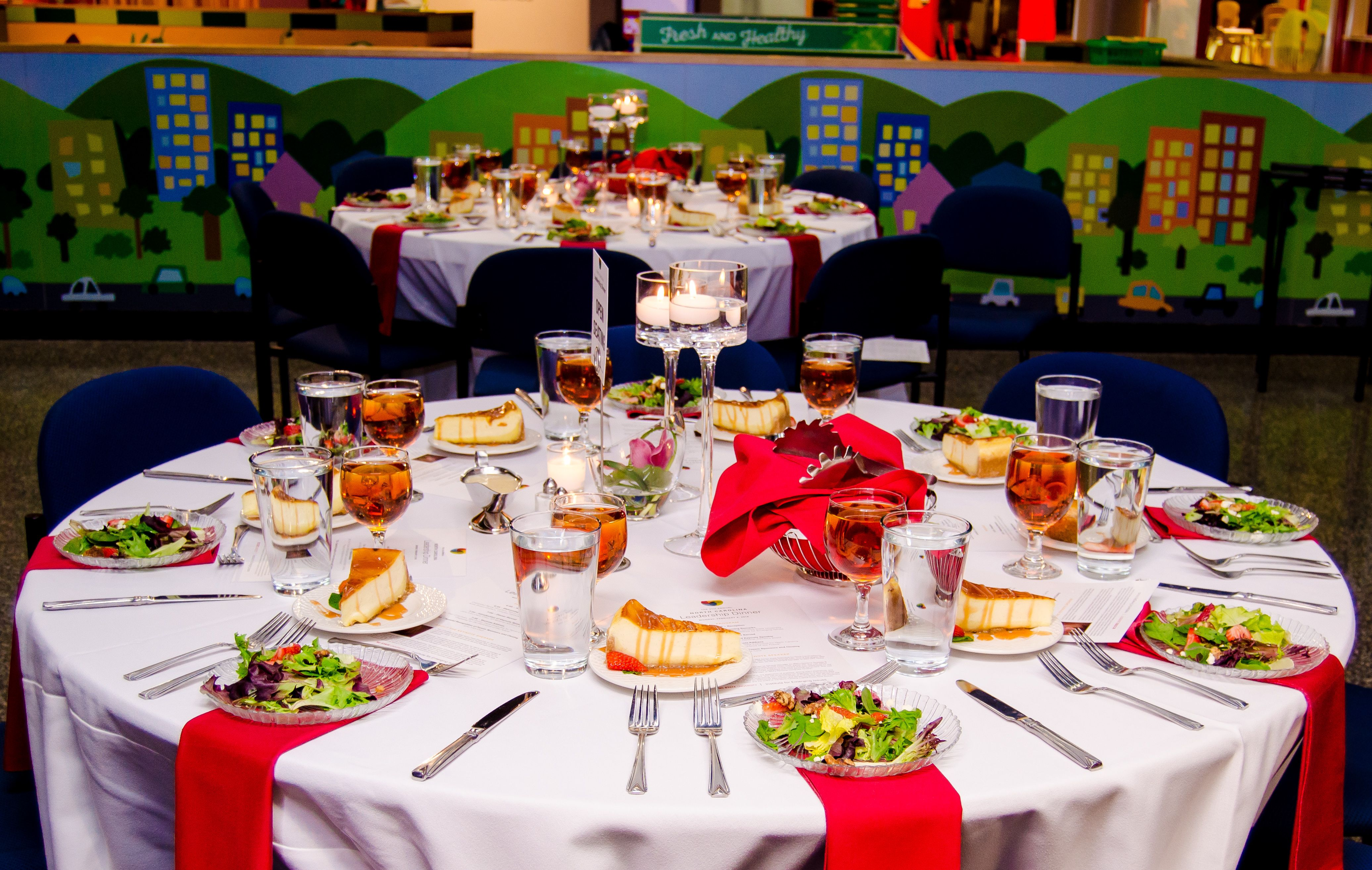 Nc Leadership Dinner At Marbles Raleigh Event Catering Beautiful Preset Tables With Salads And Cheese Cake Event Catering Catering Event
