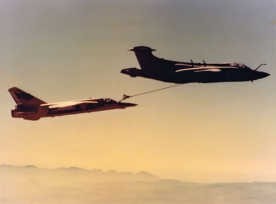 24 August 1976: The newly acquired Mirage F1AZ flown by Maj Gawie Winterbach do IFR for the first time from a SAAF Buccaneer (416) flown by Capt Sandy Allison and Capt Sandy Roy