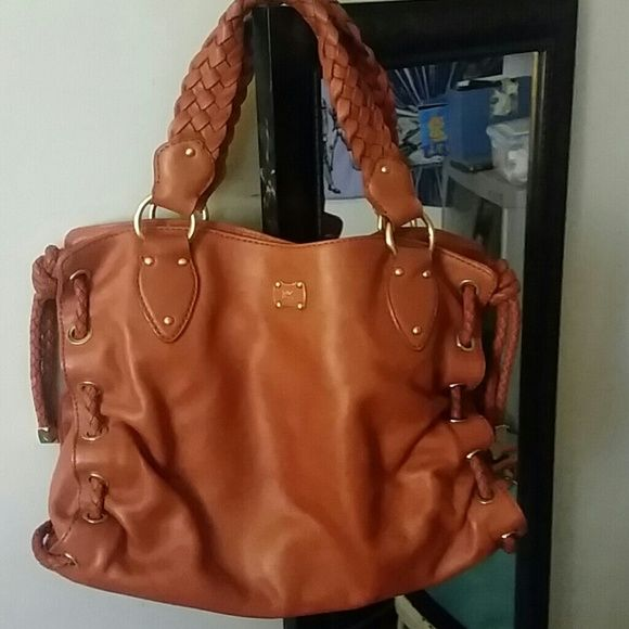 """NWOT  AUTHENTIC MICHAEL KORS BAG BRAIDED handle and side leather strings,  very unique and beautiful,  hate to let go but never have the chance to use it, gold handle rings and studs, with dust bag, length is 14"""" height is 10"""" adjustable as the side twisted strings can be adjusted to 2 or more inches. Michael Kors Bags"""