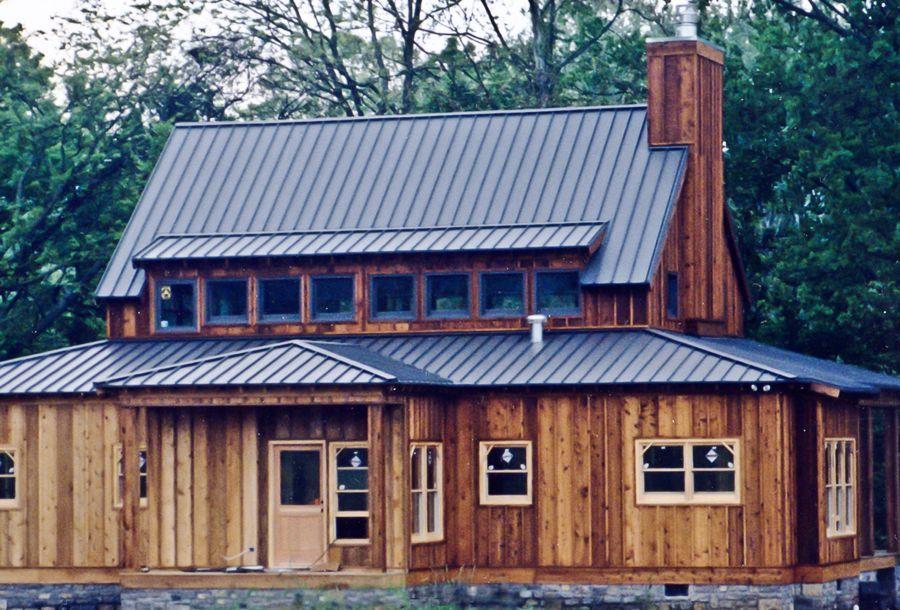 Wood Siding With Dark Gray Roof Standing Seam Metal Roof Metal Roof Metal Roofing Systems
