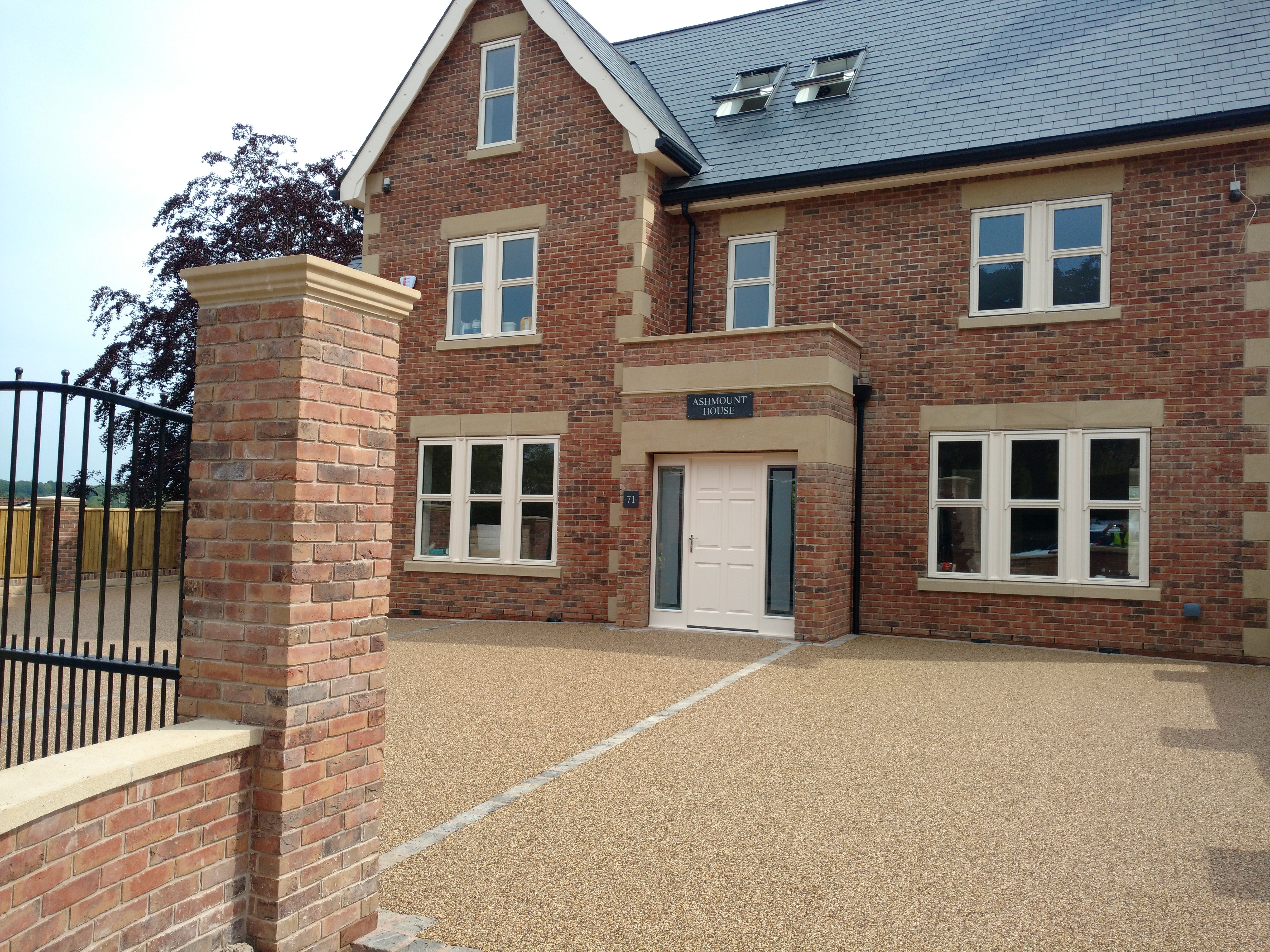 resin bound paving installed on top of a tarmac base at Dore 179m2