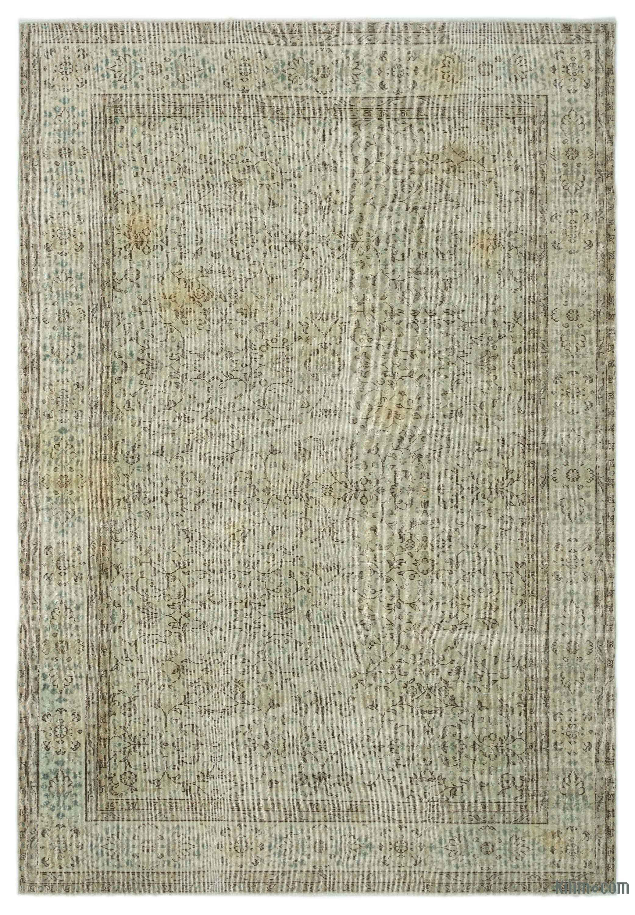 """For a contemporary look with abstract appeal, this green over-dyed rug is skillfully crafted by the revitalization of a hand knotted vintage Turkish rug. Made from wool on cotton, this """"distressed"""" rug measures 6'9'' x 9'11'' (205 cm x 302 cm). The process in creating these works of art begins by shearing to lower the pile and to help """"distress"""" them. They then undergo a series of processes to remove the color. They are now ready to be dyed in one color, a stage that can be repeated several…"""