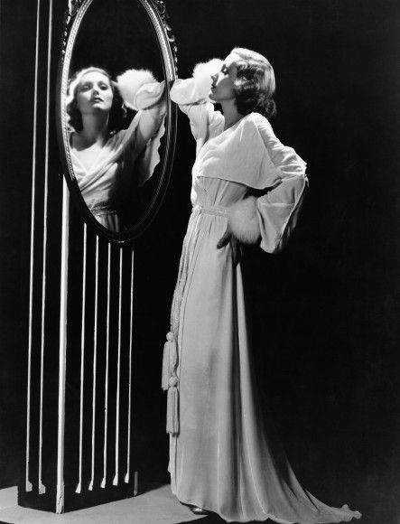 44dcde94f1f How to Care for Vintage Lingerie - This photograph of Greta Garbo in a  velvet robe is just stunning. Maribou cuffs and tassels