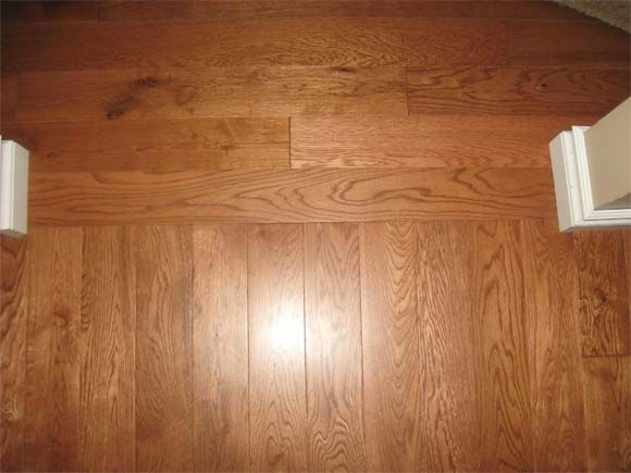Hardwood floors borders between rooms floor runs the for Wood floor 90 degree turn