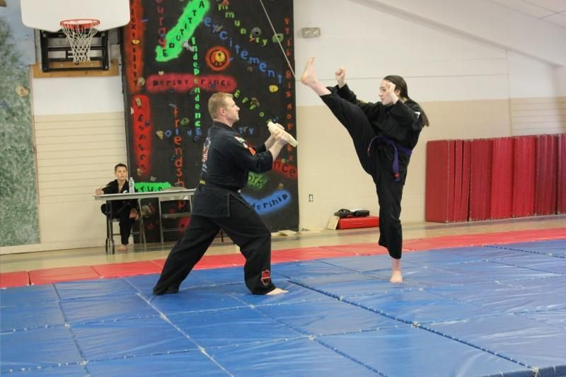 nina board breaking with ax kick for her red belt test