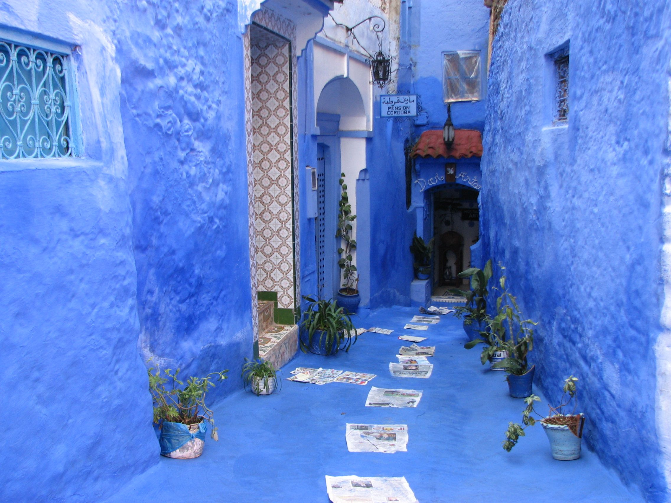 dress like a local in morroco Blue walls of Chefchaouen
