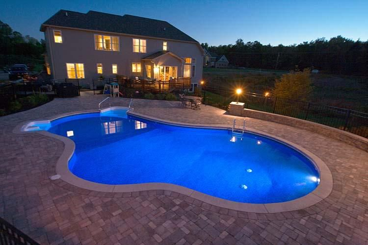 Inground Swimming Pools For Your House Unique Shape Pool White Stone Floor Two Stories Oatts Garden