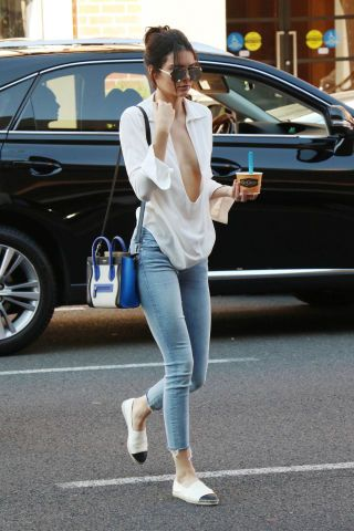 Kendall Jenner wearing Chanel flats and a Celine bag. More of her street style looks here.