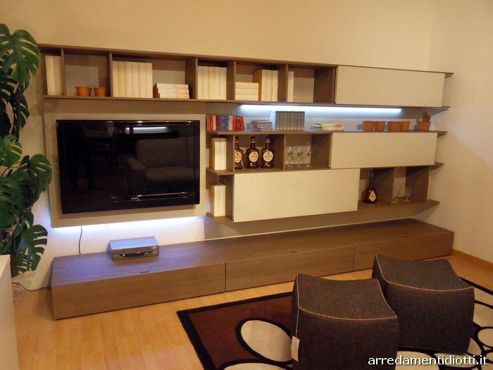 Photo of Soggiorno moderno caratterizzato da elementi libreria con ante scorrevoli – ALIA…