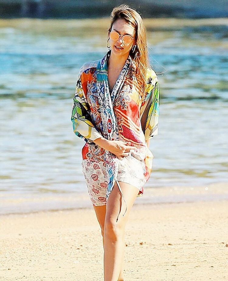 """#JWmuse @jessicaalba making us wish it was summer in the silk kimono."