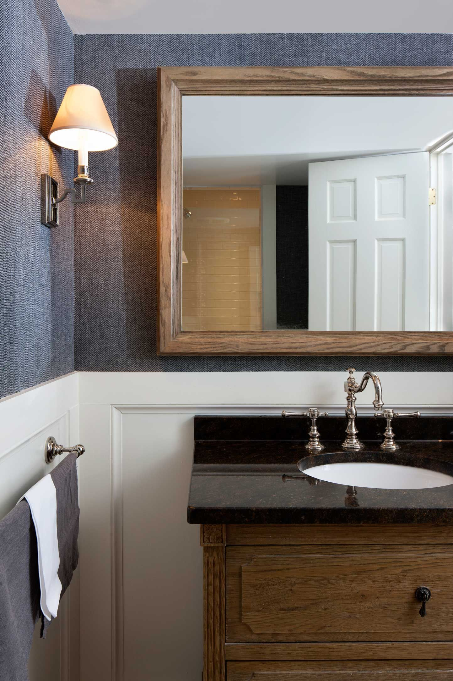 Rustic bathroom design with wooden vanity and