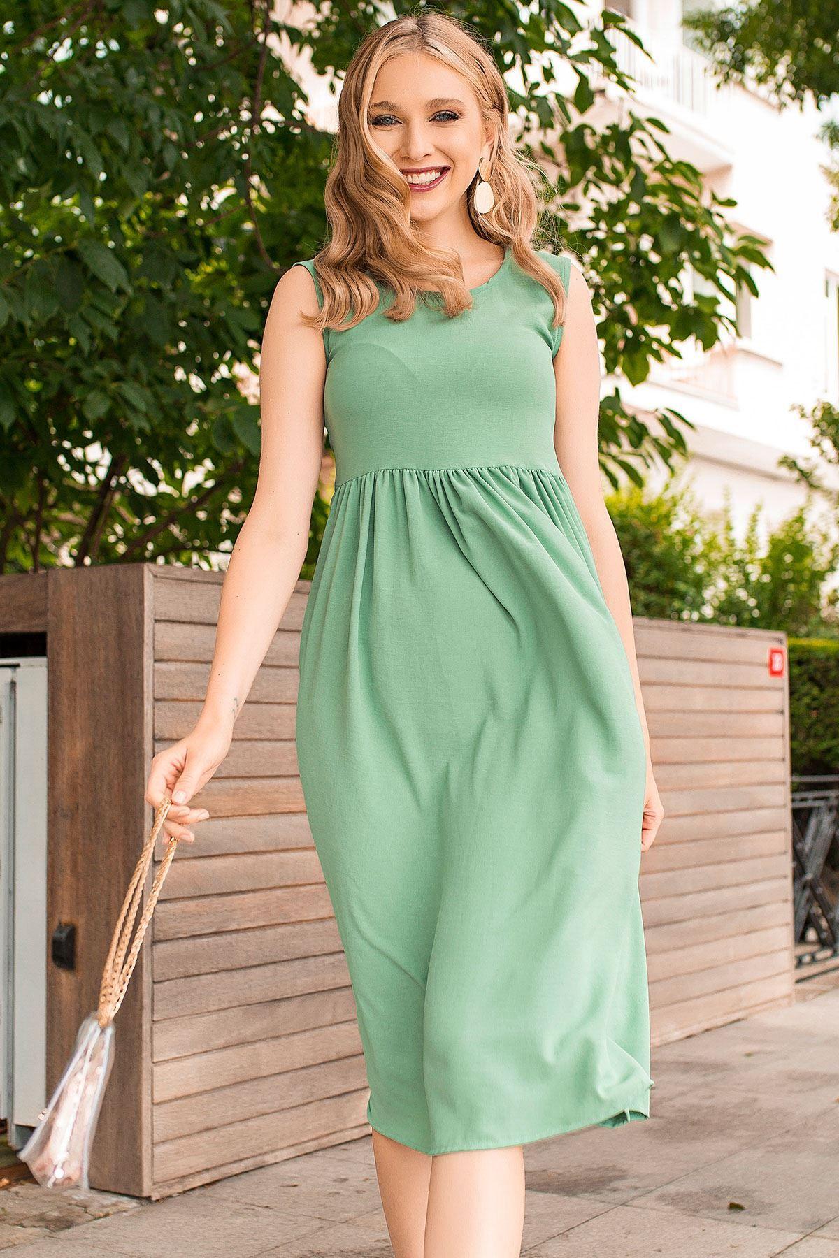 فستان صيفي فضفاض بدون أكمام لون أخضر فاتح شيك هانم Loose Dress Maxi Dress Fashion