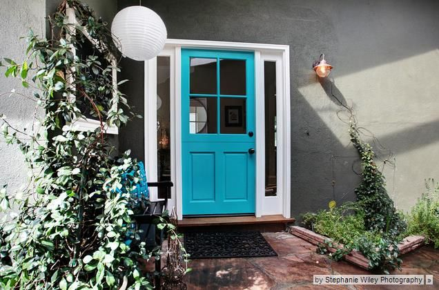 Tired of that faded front door? Try a fresh coat of colourful paint!