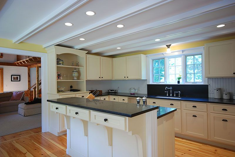 Painted shaker style overlay kitchen cabinetry with two level island ...