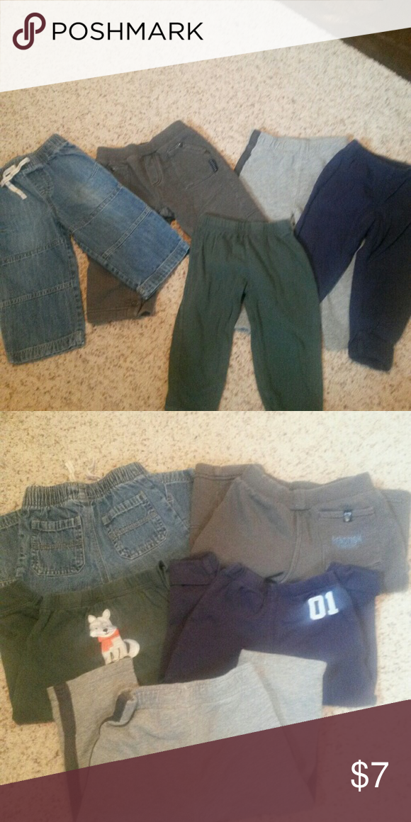 Toddler boy bundle 5 pairs toddler boy pants. All size 18 months.  1 pr jumping beans black and gray joggers, 1 pair blue stretchy pants with cuffed bottom,  carter brand, 1 pair dark green lightweight joggers with animal on bum, carter brand,  1 pr jeans with faux pockets and drawstring,  real pocket on bum, elastic waist, jumping beans brand and 1 pair heavier gray joggers with elastic waist, pockets in front and one on bum, legs snap entire way open, reaction Kenneth Cole brand Bottoms