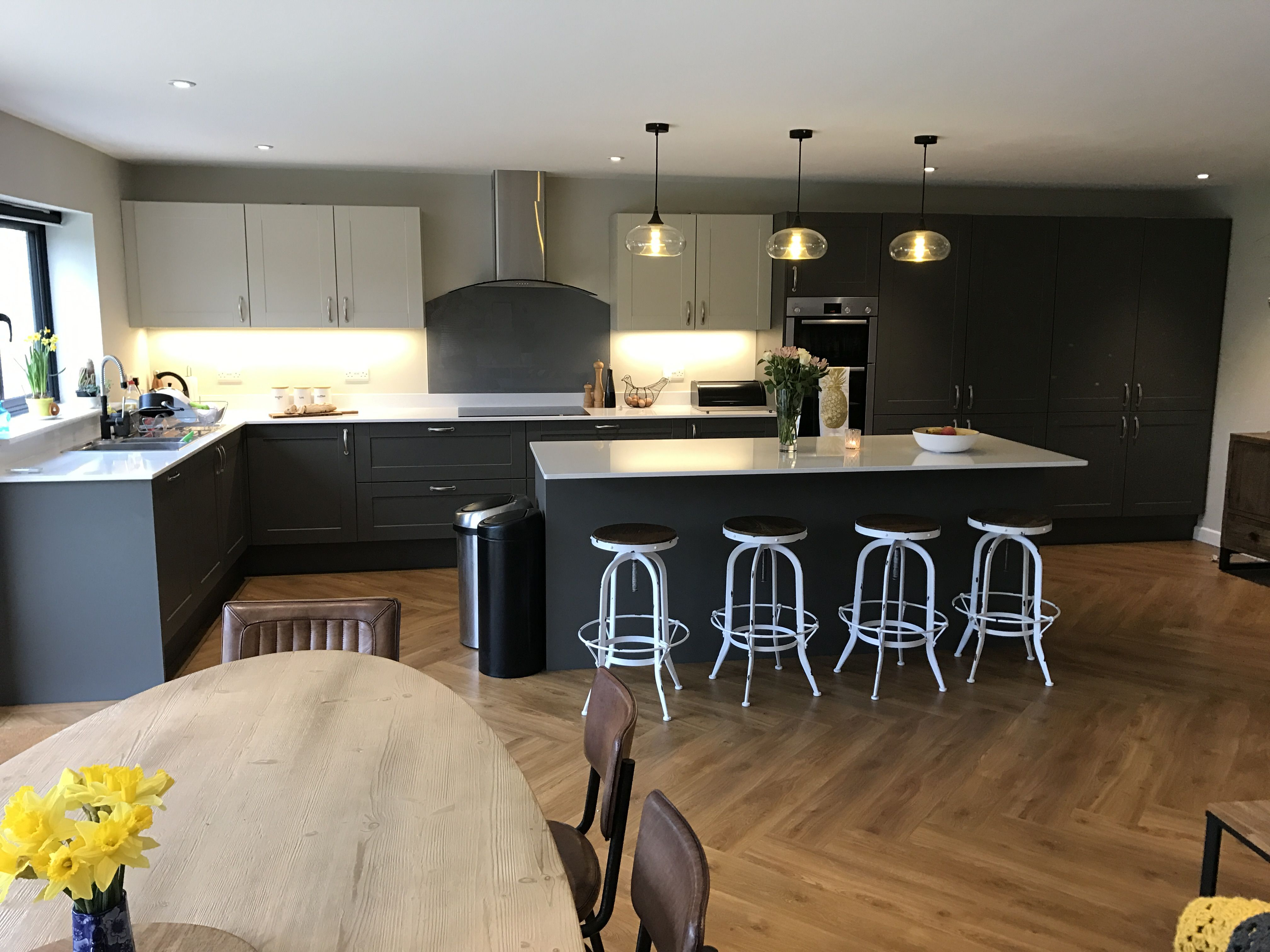 Two tone grey kitchen with island and pendant lighting and