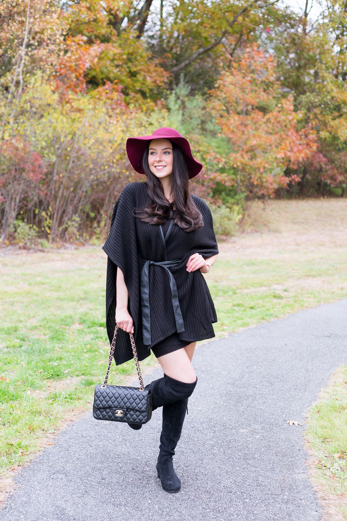 ad056371c46 Wear a belted poncho sweater in style! I paired this black sweater with a  slim