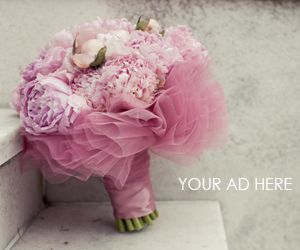 Tulle-wrapped bouquet. Sweet and pretty.