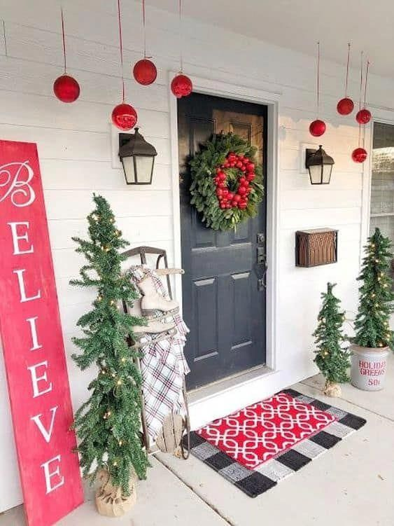 Skinny Christmas trees with LED light  #porchIdeas #porch #winter #frontDoorDecor #homeDecor #patiodecor  #christmasTree #christmasdecordiy