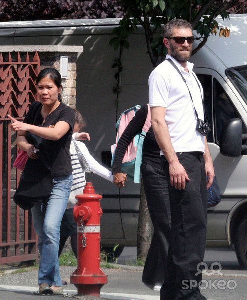 Vincent Cassel picks his daughter Deva up from school and does some shopping for his wife, Monica Bellucci, who has recently given birth to the couple's second child